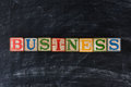 Childrens blocks spelling out business colorful on a chalk board horizontal format Stock Images