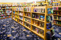 Childrens books store shelves packed with popular children s for intermediate level readers Stock Image