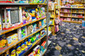 Childrens toys and books store shelves packed with for small children Stock Photo