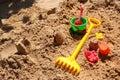 Childrens toys in a sandbox