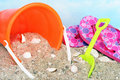Childs bucket, flip flops and shovel in sand Royalty Free Stock Photo