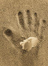 Childs Hand Print On Sand