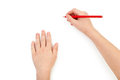 Childs hands drawing on a white paper Royalty Free Stock Photography