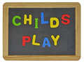 Childs play in colored letters on slate written traditional Royalty Free Stock Photography
