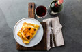 Chilean empanada served on wite plate with red wine. Top view Royalty Free Stock Photo
