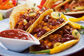 Chili con carne burrito in taco shell Stock Image