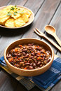 Chili con carne with homemade tortilla chips in the back photographed with natural light selective focus focus in the middle of Stock Photography