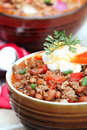 Chili con carne with sour cream served cheddar cheese and Stock Photo