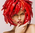 Glamour. Hot Chili Pepper on Shiny Woman's Face. Creative Concept Royalty Free Stock Photo