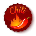 Chili peppers in fire.