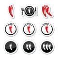 Chili peppers hot and spicy food icons set vector red black labels of isolated on white Royalty Free Stock Photography