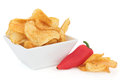 Chili potato crisp snacks porcelain dish red pepper over white background Royalty Free Stock Image