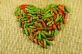 Chili s heart love on top the threshing basket Royalty Free Stock Image