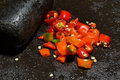 Chili sliced red on molcajete ready to be crush Stock Images