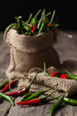 Chill in burlap sack on wooden background Royalty Free Stock Photography