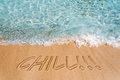 Chill concept sign on the beach sand Stock Images