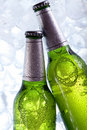 Chilled beer in ice! Royalty Free Stock Photo