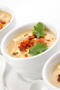 Chilled corn and bacon soup three bowls of garnished with cooked fresh cilantro smoked paprika Royalty Free Stock Photos