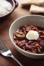 Chilli con carne a bowl of with a dollop of mayonnaise on top Royalty Free Stock Images