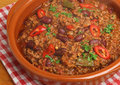 Chilli con carne mexican in a terracotta serving dish Royalty Free Stock Images