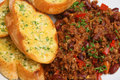 Chilli with garlic bread con carne served and herb Stock Photo