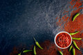 Chilli and garlic relish on dark slate black background from above Royalty Free Stock Photo