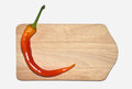 Chillies, red pepper on wooden board Royalty Free Stock Photo