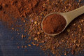 Chilly powder on a dark wooden background Royalty Free Stock Photos