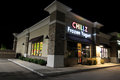 Chillz frozen yogurt at night image of the store Stock Photos