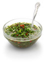 Chimichurri traditional argentine condiment sauce is a made from finely chopped parsley minced garlic olive oil oregano and wine Royalty Free Stock Image