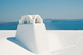 Chimney in oia on santorini island in greece with caldera view at background Stock Photos