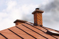 Brick chimney of old house with solid fuel stove Royalty Free Stock Photo