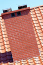 Chimney and red roof tiles Royalty Free Stock Images