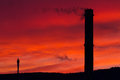 Chimney and red sky a front of the Royalty Free Stock Image