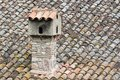 Chimney and roof of bent tiles Stock Photo