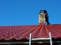 Chimney sweep man with special wire brush on roof clean Royalty Free Stock Photography