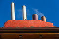 Chimneys with smoke chimney blue sky background Royalty Free Stock Images