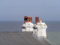 Chimneys two chimney stacks on a roof at the seaside Royalty Free Stock Image
