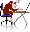 Chimpanzee with computer Stock Image