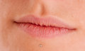 Chin piercing close up shot of a feminine mouth with a Royalty Free Stock Images