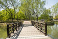 China asia beijing the olympic forest park garden landscape,the wooden bridge in a set of tourism leisure and entertainment Royalty Free Stock Photo