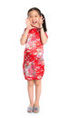 China girl shouting happy chinese new full length in traditional cheongsam dress year to everyone standing isolated on Royalty Free Stock Image