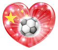 China soccer heart flag football ball love concept with the chinese in a shape and a ball flying out Royalty Free Stock Image