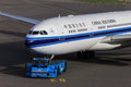 China southern jet being towed a airlines airbus a is by a klm tug Royalty Free Stock Photos