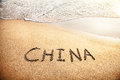 China title on the sand beach near ocean Royalty Free Stock Image