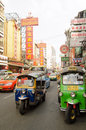 Chinatown traffic bangkok thailand october cars buses and tuk tuk auto rickshaws traveling along a congested road through the Royalty Free Stock Photo