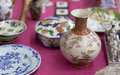 Chinaware chinawares for sale at an antique stand Royalty Free Stock Photo