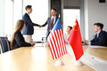 Chinese and American leaders shaking hands on a deal agreement. Royalty Free Stock Photo