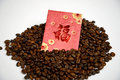 Chinese ang pao and coffee bean isolated over white background Royalty Free Stock Photos