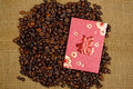 Chinese ang pao and coffee bean over burlap background Stock Image